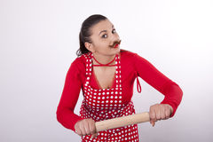 Young attractive housewife. With rolling pin and moustaches Stock Image