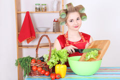 Young attractive housewife with vegetables Stock Photography