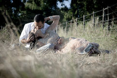 Young attractive Indian couple kissing in field Royalty Free Stock Images