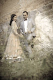 Young attractive Indian couple standing together outdoors Stock Photo