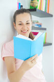 Young attractive lady with a book Royalty Free Stock Photography