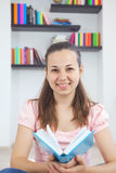Young attractive lady with a book Royalty Free Stock Images