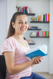 Young attractive lady with a book Stock Images