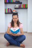 Young attractive lady with a book Stock Photo