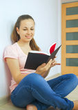 Young attractive lady with a book Stock Image