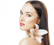 Young attractive lady close up with hands on face  flower lily brunette spa nude makeup Stock Image