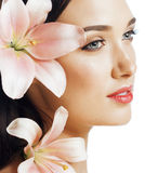 Young attractive lady close up with hands on face isolated flower lily brunette spa Stock Images