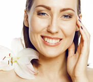 Young attractive lady close up with hands on face isolated flower lily brunette spa nude makeup Royalty Free Stock Photos