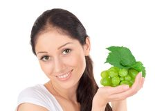 Young attractive lady with green grape cluster Stock Images