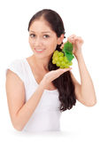 Young attractive lady with green grape cluster Stock Photos