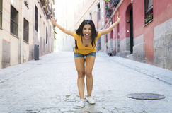 Young attractive latin woman happy and excited posing on modern urban European city Royalty Free Stock Photo