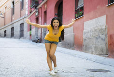 Young attractive latin woman happy and excited posing on modern urban European city Stock Photos