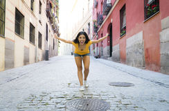 Young attractive latin woman happy and excited posing on modern urban European city Stock Image