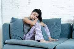Young woman at home feeling depressed and sad royalty free stock image