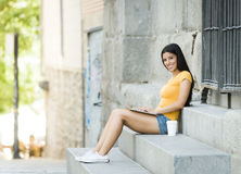 Young attractive latin woman in trendy casual clothes studying or working on laptop computer Stock Image