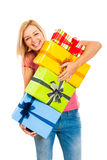 Young attractive laughing woman with gifts Royalty Free Stock Photography