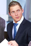 Young attractive, looking busy businessman Stock Image