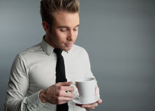 Young attractive macho drinking coffe Royalty Free Stock Images