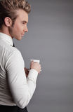 Young attractive macho drinking coffe Royalty Free Stock Photo