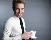Young attractive macho drinking coffe Stock Photos