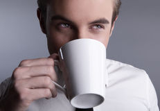 Young attractive macho drinking coffe Royalty Free Stock Image