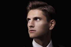Young attractive macho in suit Stock Photography