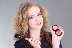 Young attractive make up artist with brush Royalty Free Stock Photos