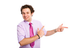 Young attractive male pointing right and up Royalty Free Stock Photography