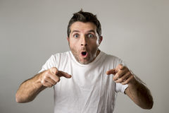 Young attractive man astonished amazed in shock surprise face expression and shock emotion Royalty Free Stock Photos