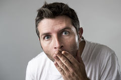 Young attractive man astonished amazed in shock surprise face expression and shock emotion Stock Images