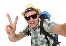 Young attractive man or backpacker student taking selfie photo with mobile phone or camera stock photo