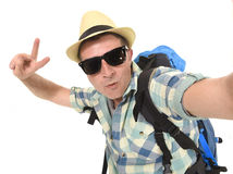 Young attractive man or backpacker student taking selfie photo with mobile phone or camera stock images