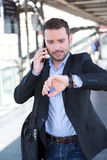 Young attractive man being late to an appointment Stock Images