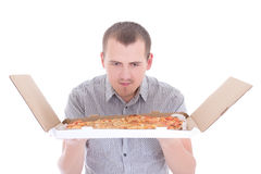 Young attractive man with big pizza isolated on white Stock Image