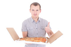 Young attractive man with big pizza thumbs up isolated on white Stock Images