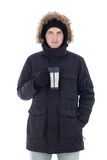 Young attractive man in black winter jacket with mug of tea isol Stock Photography