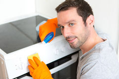 Young attractive man cleaning his flat Royalty Free Stock Photography