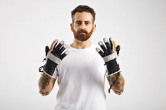 Young attractive man demonstrating snowboard gloves stock photos