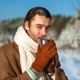 Young attractive man drinking tea outside Stock Photo