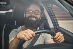 A modern bearded man driving a car Stock Photography