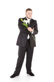 Young attractive man with flowers orchids. Attractive  man with flower. Isolated over white Royalty Free Stock Image