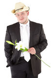 Young attractive man with flowers orchids. Attractive  man with flower. Isolated over white Stock Images