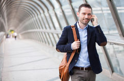Young attractive man having a call in a airport hall Stock Photo
