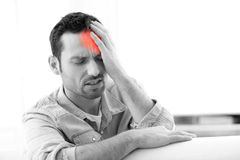 Young attractive man with a headache Stock Photos