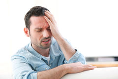Young attractive man with a headache Royalty Free Stock Photography
