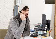 Young attractive man in hipster beanie and trendy style businessman working in stress Royalty Free Stock Photos