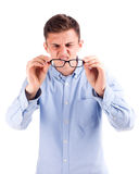 Young attractive man hold glasses isolated Royalty Free Stock Image