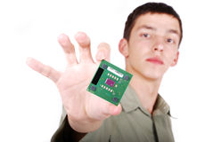 Young attractive man holding computer processor Stock Images