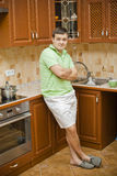 A young attractive man in the kitchen Royalty Free Stock Photos