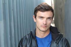 Young attractive man looking at camera - Stock image Stock Photo